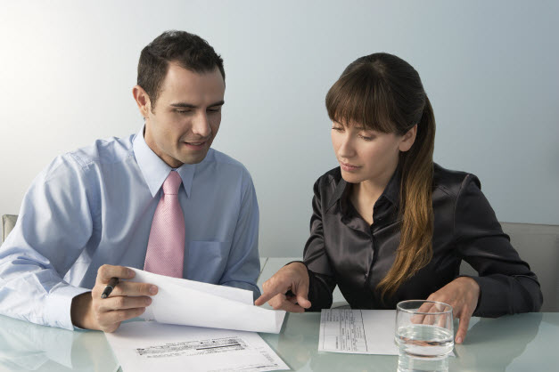 Two business people working at an office table